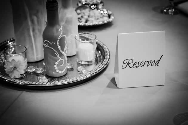 Black and white photo of a reserved place at a table