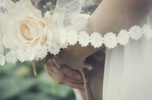 A brides hands and bouquet