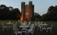 Candle lit tables at Leez Priory