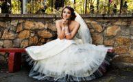 Bride sitting in her wedding dress