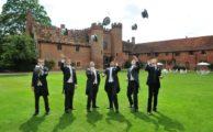 Groomsmen throwing their hats